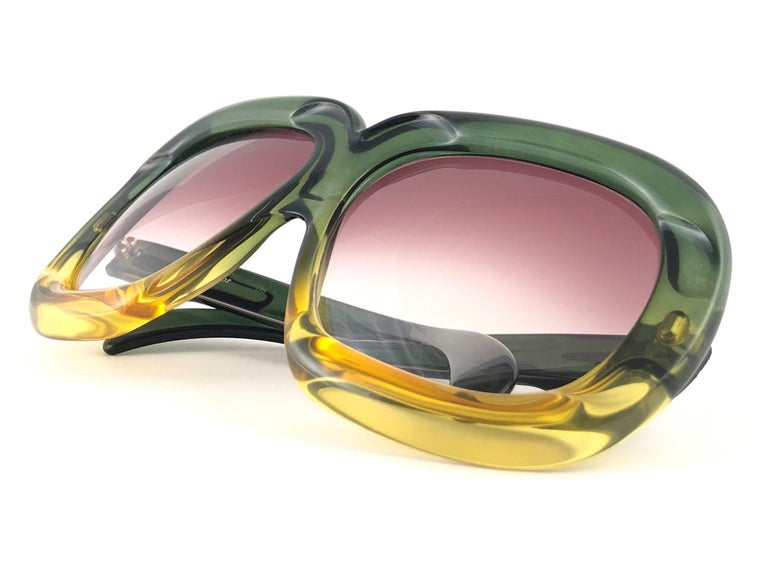 New Vintage Christian Dior D10 Oversized two tone ombre green and amber frame sporting spotless mauve gradient lenses.   Produced and design in 1970's.  New, never worn or displayed. This item may show minor sign of wear due to storage.  FRONT 15