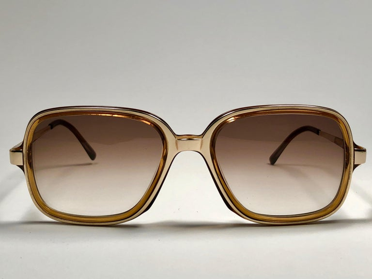 New vintage Christian Dior Monsieur gold & amber details frame.  Spotless brown gradient lenses.  Comes with it original CD Monsieur sleeve.   Made in Austria  Front : 14 cms  Lens Height : 4.2 cms  Lens Width : 5 cms  Temples : 12.5 cms