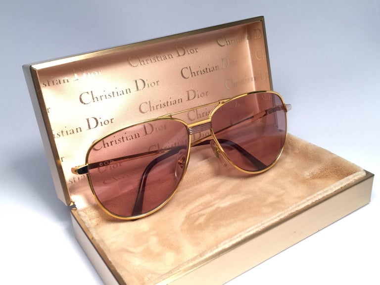 New Vintage Christian Dior Monsieur Titanium in Gold.  Designed and produced in the 1980's.    Made by Optyl. Manufactured in Germany.     New! never worn or displayed. Flawless pair!