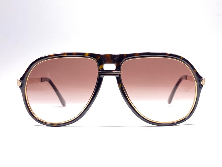 New 1980 Dunhill oversized dark tortoise frame.  Light gradient brown (uv protection) lenses.  These are like a pair of jewels on your nose. Beautiful design and a real sign of the times.  Original Dunhill case. This piece may show minor sign of