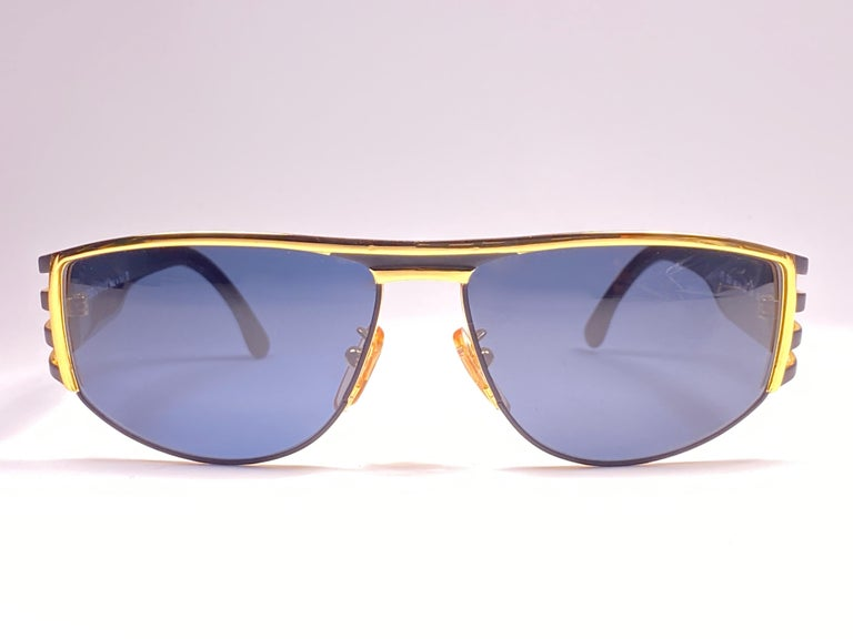 New Fendi gold & black large frame with solid grey ( UV protection ) lenses.  Made in Italy.   Produced and design in 1990's.  New, never worn or displayed. this  item may show minor sign of wear due to storage.