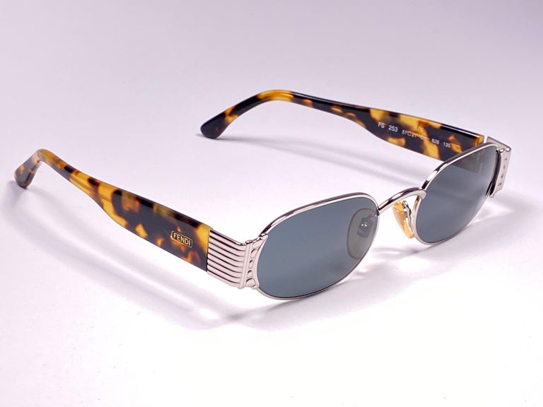 New Fendi silver & tortoise large frame with solid grey ( UV protection ) lenses.  Made in Italy.   Produced and design in 1990's.  New, never worn or displayed. this  item may show minor sign of wear due to storage.  MEASUREMENTS   FRONT : 13.5