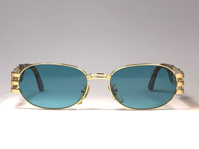 New Fendi gold oval frame with turquoise  ( UV protection ) lenses.  Made in Italy.   Produced and design in 1990's.  New, never worn or displayed. this  item may show minor sign of wear due to storage.