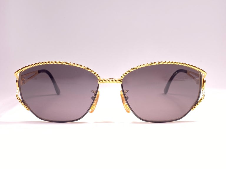 New Fendi gold & black oval large frame with solid grey ( UV protection ) lenses.  Made in Italy.   Produced and design in 1990's.  New, never worn or displayed. this  item may show minor sign of wear due to storage.
