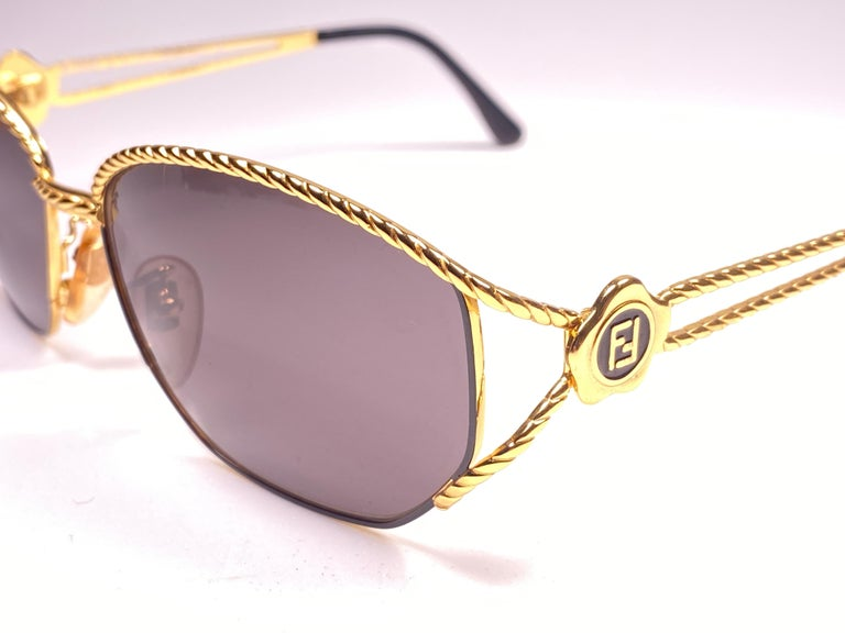 New Vintage Fendi SL7023 Gold & Black Large  1990 Sunglasses Made in Italy In New Condition For Sale In Amsterdam, Noord Holland
