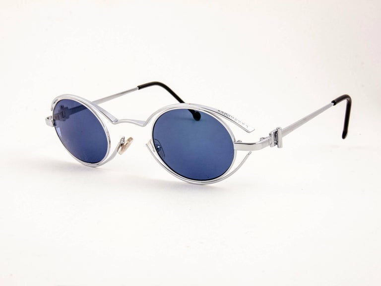 New Vintage amazing pair of vintage 1980's 4123 04 Karl Lagerfeld oval silver sunglasses framing a pair of smoke grey lenses.    New, never worn or displayed. Designed and produced in France.