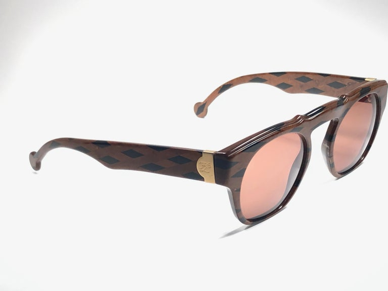 Amazing pair of New vintage 1980's Karl Lagerfeld black & brown mosaic sunglasses framing a pair of amber lenses.    New, never worn or displayed. This pair may show minor sign of wear due to storage. A true fashion statement .