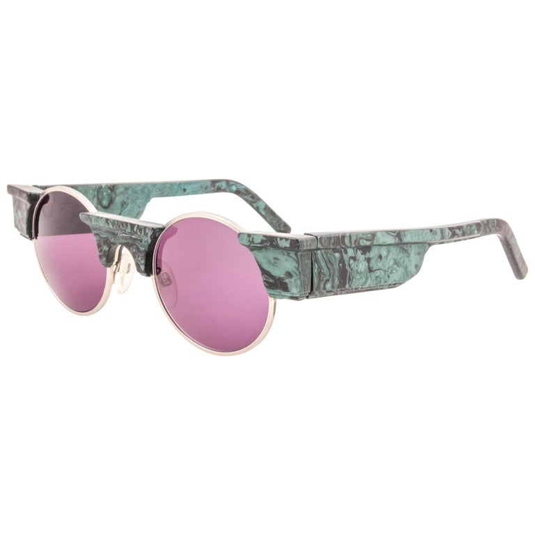 Striking pair of vintage Karl Lagerfeld Round green marbled sunglasses sporting a spotless pair of rose lenses. Superb design emulating ancient greek architecture.    Although it has never ever been used or displayed could show minor sign of wear