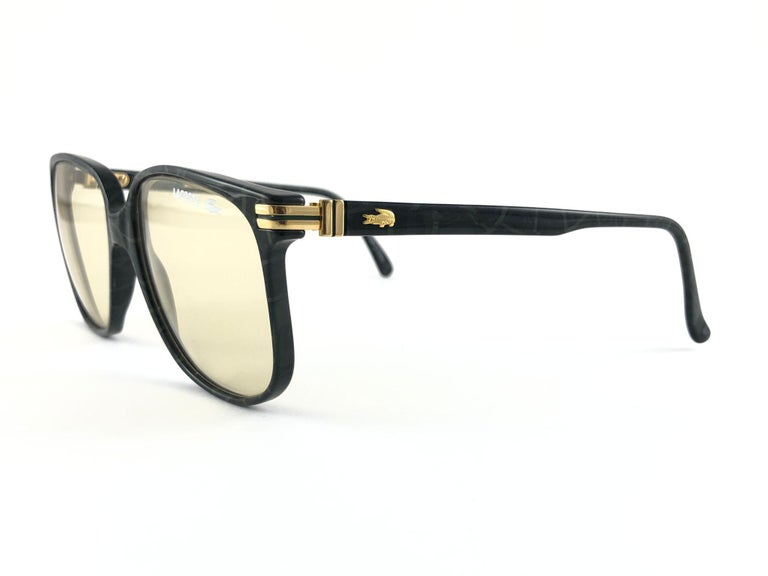 Sunglasses circa 1980's by Lacoste.  Please noticed this item its nearly 40 years old and has been on a private collection, therefore the frame show sign of wear according to age and minimum wear.  Made in France.  MEASUREMENTS   FRONT : 14 CMS LENS