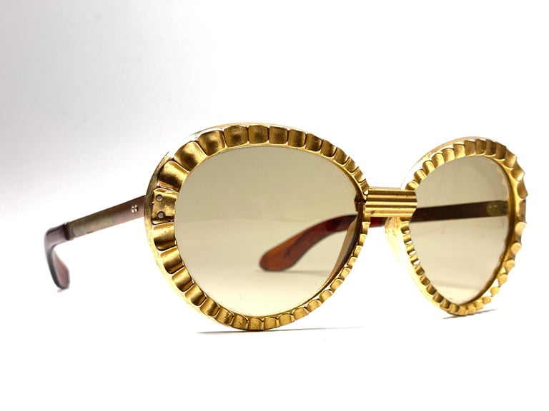 New Vintage Collector Item 1950's Michelle Brevet oversized brass frame holding a spotless pair of brown lenses.  Handmade in France in the 50's.  This pair show minor sign of wear in a form of oxidation due to storage.   No structural