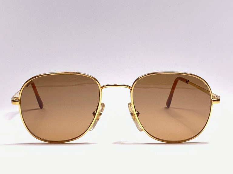 New Vintage Moschino medium size gold frame  Spotless gold mirrored lenses.  Made in Italy.   Produced and design in 1990's.  This item may show minor sign of wear due to storage.