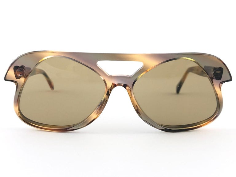 Vintage new Cardin with spotless medium brown lenses made in the 1960's . Ultra rare design, hardly seen up for sale.  New, never used or displayed this pair of vintage pierre cardin is a rare and sought after piece not to miss out!  This pair may