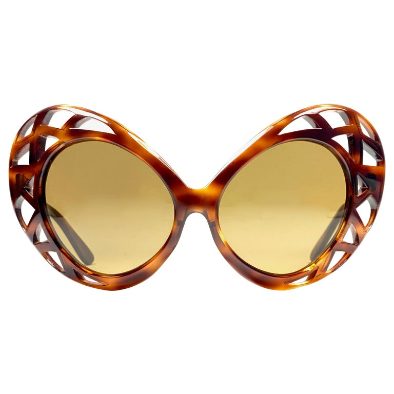 Vintage new Pierre Cardin Oversized dark carey frame sporting a pair of solid brown lenses.  Designed and produced in the 1960's.     This pair of vintage Pierre Cardin is a collectors must have.   A piece of sunglasses and fashion history.  This