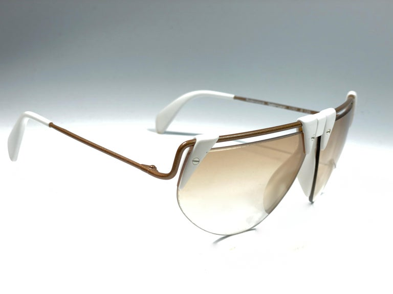 New Vintage Rodenstock sunglasses.    Polar white accents frame sporting a pair light gradient lenses.  Never worn or displayed.  This item show minor sign of wear due to nearly 40 years of storage.  Designed and produced in Germany.