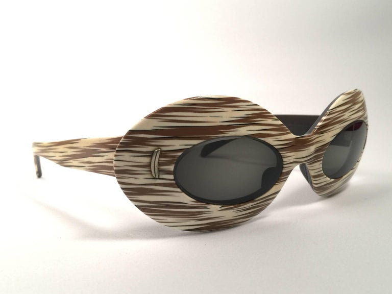 Mint Vintage Suntimer Victory Skimo style sunglasses. Iconic striped frame with G15 grey lenses.  Please notice this item its almost 60 years old and may show minor sign of wear due to storage.  An original and seldom piece.