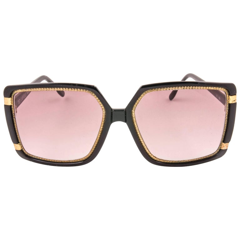 New Vintage Ted Lapidus TL 15 01 black & gold frame with spotless light purple  lenses.   Made in Paris.   Produced and design in 1970's.   New, never worn or displayed.  MESUREMENTS   FRONT : 15 CMS  HEIGHT : 5 CMS WIDTH : 5.5 CMS