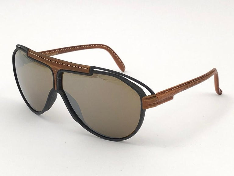 Beautiful and stylish YSL sunglasses. Man made leather frame holding a pair of double gradient lenses with beautiful old Cassandre logo. This pair show minor sign of wear due to storage, Please study the pictures.  A great opportunity to achieve a