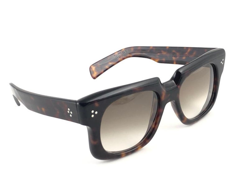 New vintage Zollitsch 302 robust oversized dark tortoise frame. Spotless light brown gradient  lenses. This pair have slight wear on them due to to nearly 40 years of storage.      FRONT : 15 CM LENS  HEIGHT : 4.2 CMS LENS WIDTH : 5.2 CMS TEMPLES :