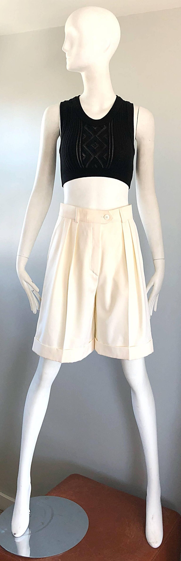 Chic late 1980s ESCADA by MARGARETHA LEY new with original store tags ivory / off-white wide leg culottes shorts! Flattering pleated front with pockets at each side of the waist. Button closure at front center with a zipper fly. Super soft