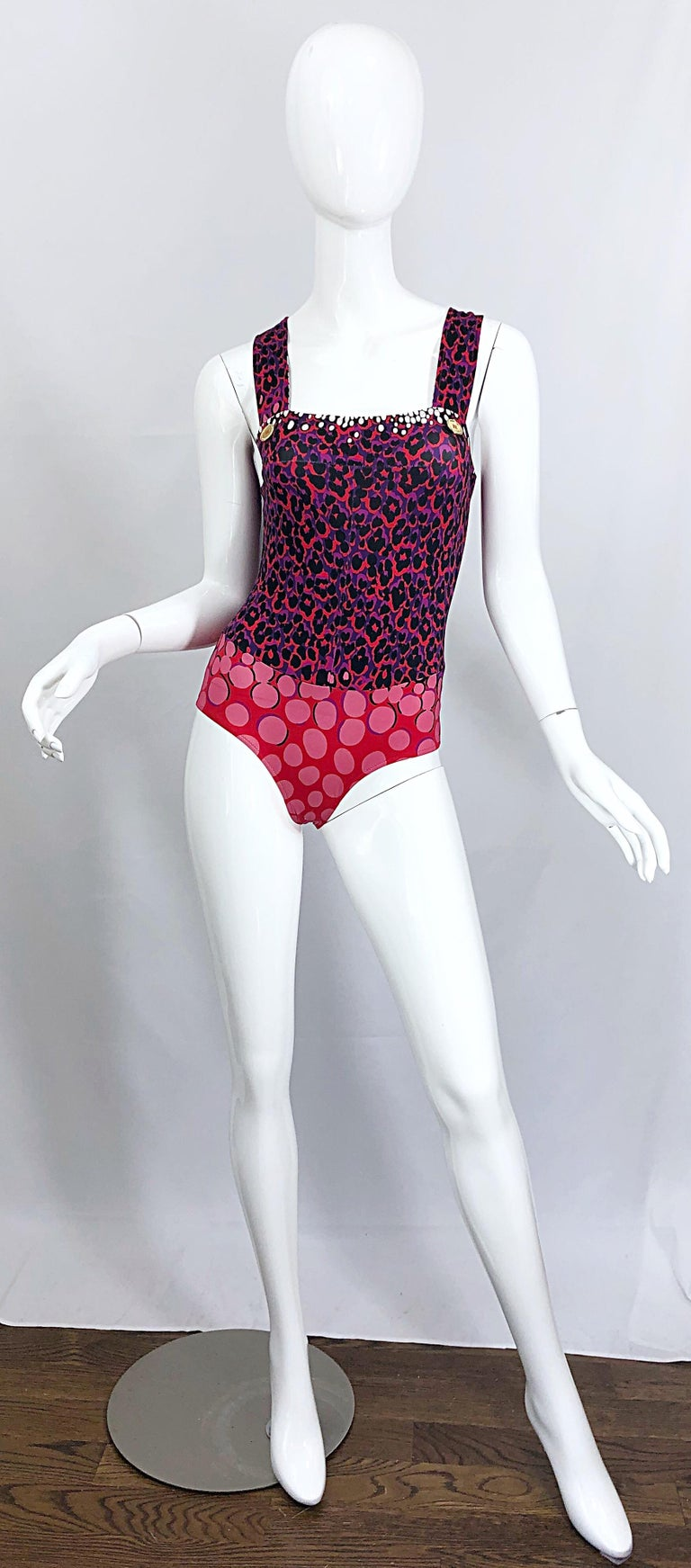 Sexy new YVES SAINT LAURENT purple and red leopard print and polka dot one piece swimsuit or bodysuit! Features a leopard print on the bodice and abstract polka dots on the bottom. Two gold buttons at each strap. Great for the beach, pool, yacht.