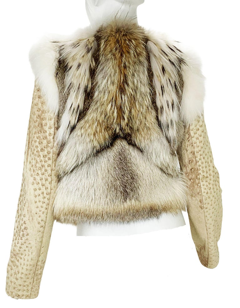 New Yves Saint Laurent Ostrich Shearling Lined Jacket Designer size 40 - US 4 Beige/Soft Brown Colors, Ostrich, Fox, Rabbit, Fully Lined in Shearling, Zip Closure. Measurements: Length - 19 inches, Bust - 32/34