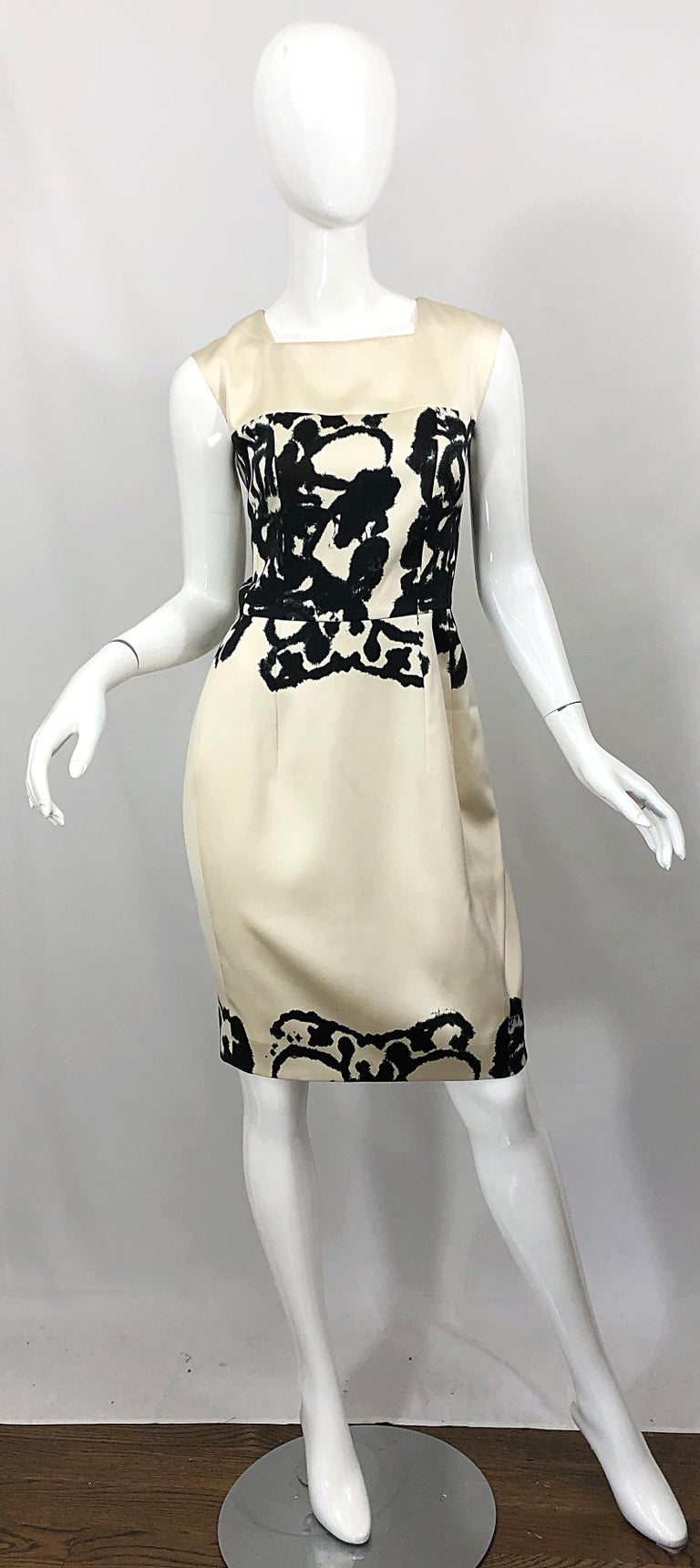Chic brand new YVES SAINT LAURENT ( YSL ) ivory and black abstract print sleeveless silk dress! Sleek tailored bodice with a square neckline. Abstract black print on the front and back bodice and at bottom hem. Hidden zipper up the back with