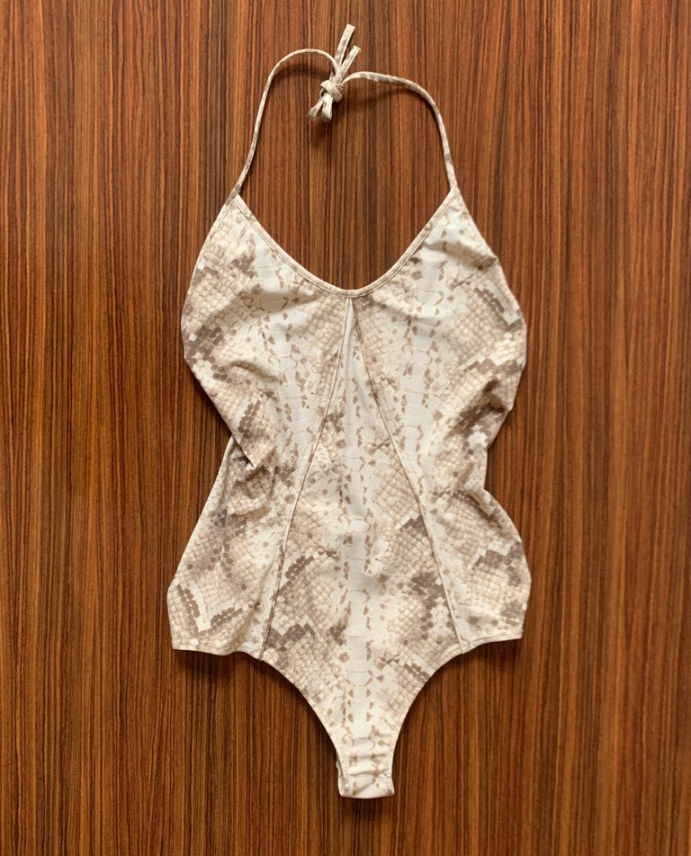 Yves Saint Laurent tan and grey reptile print backless swimsuit with halter top. Seam detail at front. Tie closure.   80% nylon, 20% elastane. Lined in nylon.  Made in Italy.  Size FR 40, approximate US 8. Lots of stretch, measurements taken