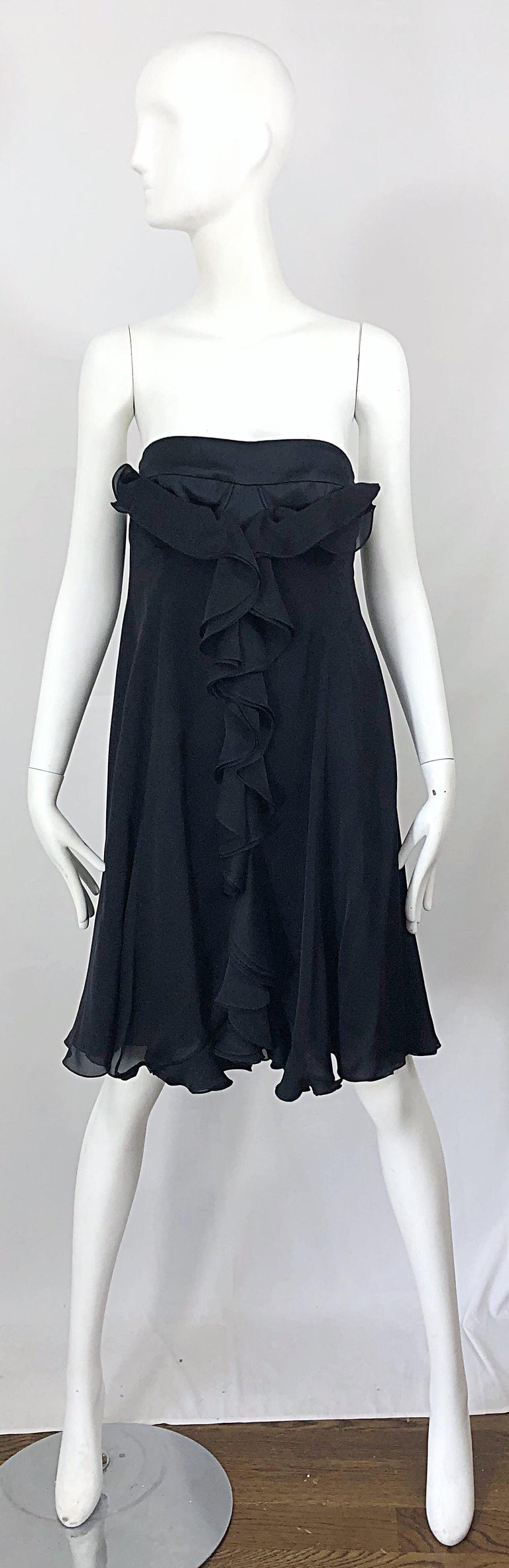 Chic brand new with tags YVES SAINT LAURENT Spring 2008 black silk strapless dress! Features intricate interior corset boning that holds everything in place. Hidden zipper up the side with hook-and-eye closure. Additional lace closures at back with