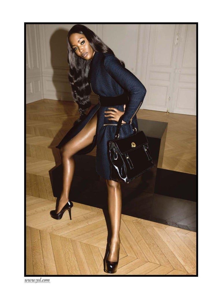 Yves Saint Laurent Brand New  Featured in the Naomi Campbell Ad $2950 F/W Runway 2008 Heavy Coat Size: FR38 100% Heavy Virgin Wool & Silk Black Quilting Throughout Dual Zipper Front Pockets Zip Accents at Sleeves Zips up the Front Fully