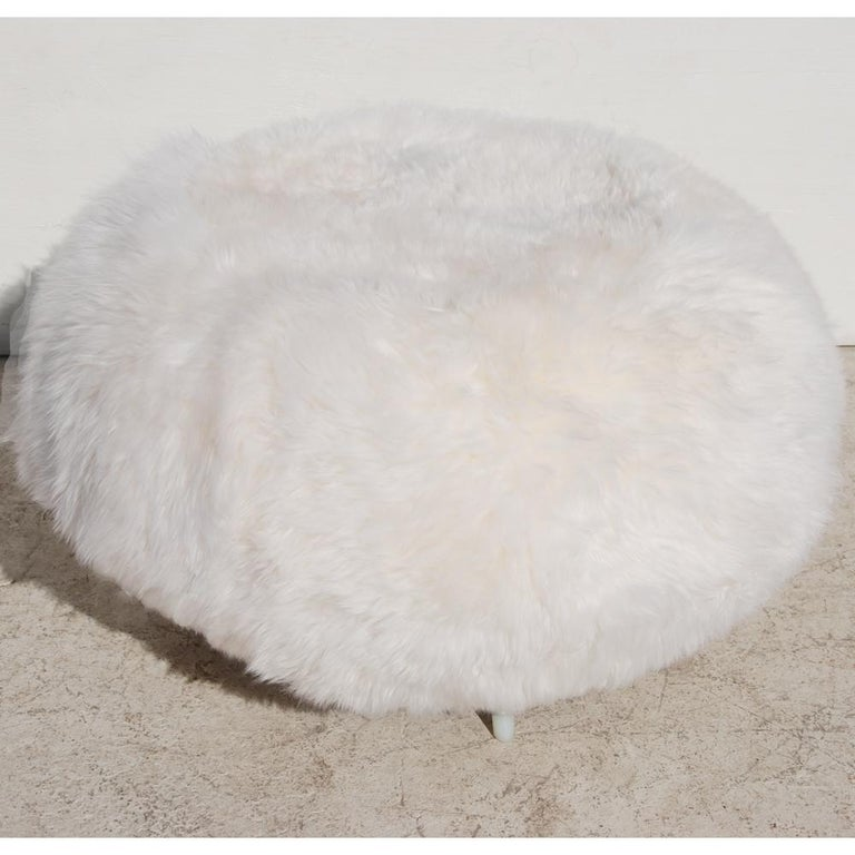 Ottoman restored in New Zealand Sheepskin by Allermuir  Recently reupholstered in soft sheepskin on a brushed aluminum base.  Marked with manufacturer.
