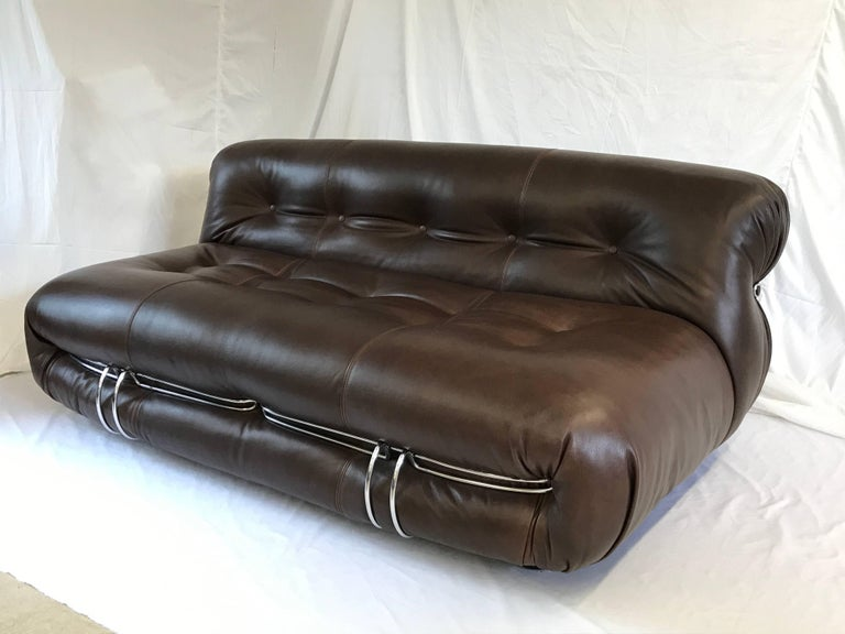 Soriana Sofa design Tobia Scarpa 1970s manufactured by Cassina. This medium version sofa with two front metal clamps will be sold with brand new leather or velvet upholstery. included in the price. Work is performed in Italy by our professional