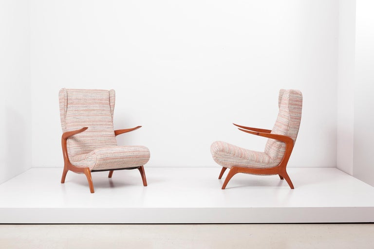 Newly upholstered lounge chair and stool set, Italy, 1950s