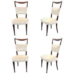Newly Upholstered Set of Four Osvaldo Borsani Rosewood and Velvet Dining Chairs