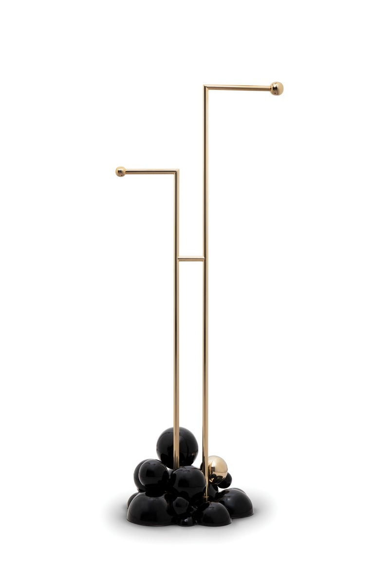 Newton is a three-tier towel rack produced in polished brass and supported by gold and black spheres. It is a revolutionary statement piece created to fulfill the needs of those who are looking for the best in contemporary furniture design mixed