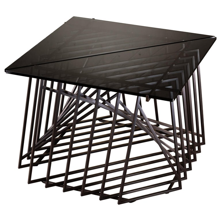 The nexus end tables are an original design, fabricated in house by Force/Collide. These side tables are a sculptural study crafted by hand from blackened steel and gray glass. Versatile and modular, the triangular tables can be fully customized to