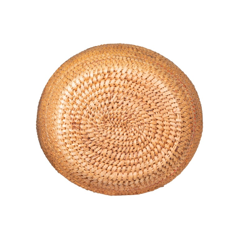 Native American Nez Perce huckleberry basket collected Sites, Idaho. Store twine rim loops with brain tanned shoulder straps. Heavily constructed. Once had red and blue accepts now faded. Cylindrical style top. Berry stains from use.  Period: Last