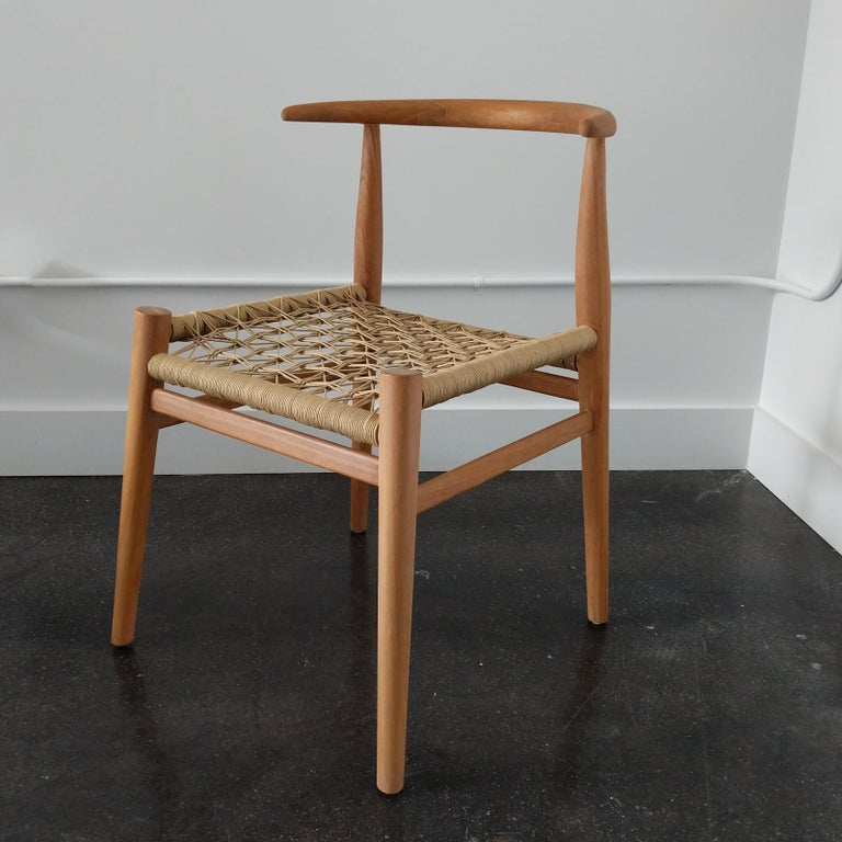 Hand-Carved Nguni Dining Chair in Iroko with Crosshatch Weave For Sale