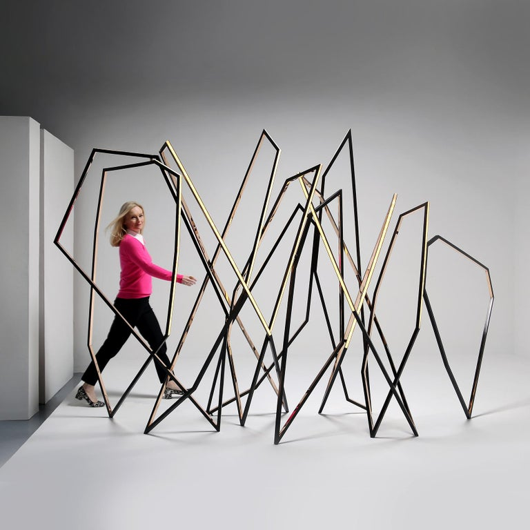 In many of her most powerful sculptures Niamh Barry abandons her signature fluid ellipses for compositions of sharp angles arranged in dynamic, crisscrossing lines-forms that suggest a whole different category of motion. With walking, one of Barry's