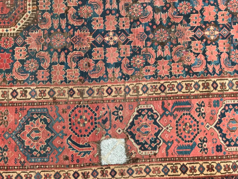 Beautiful 19th century long Beshir rug with a nice geometrical tribal design and beautiful natural colors with red, blue, green and brown, some damages and reparations. Entirely hand knotted with wool velvet on wool foundation.