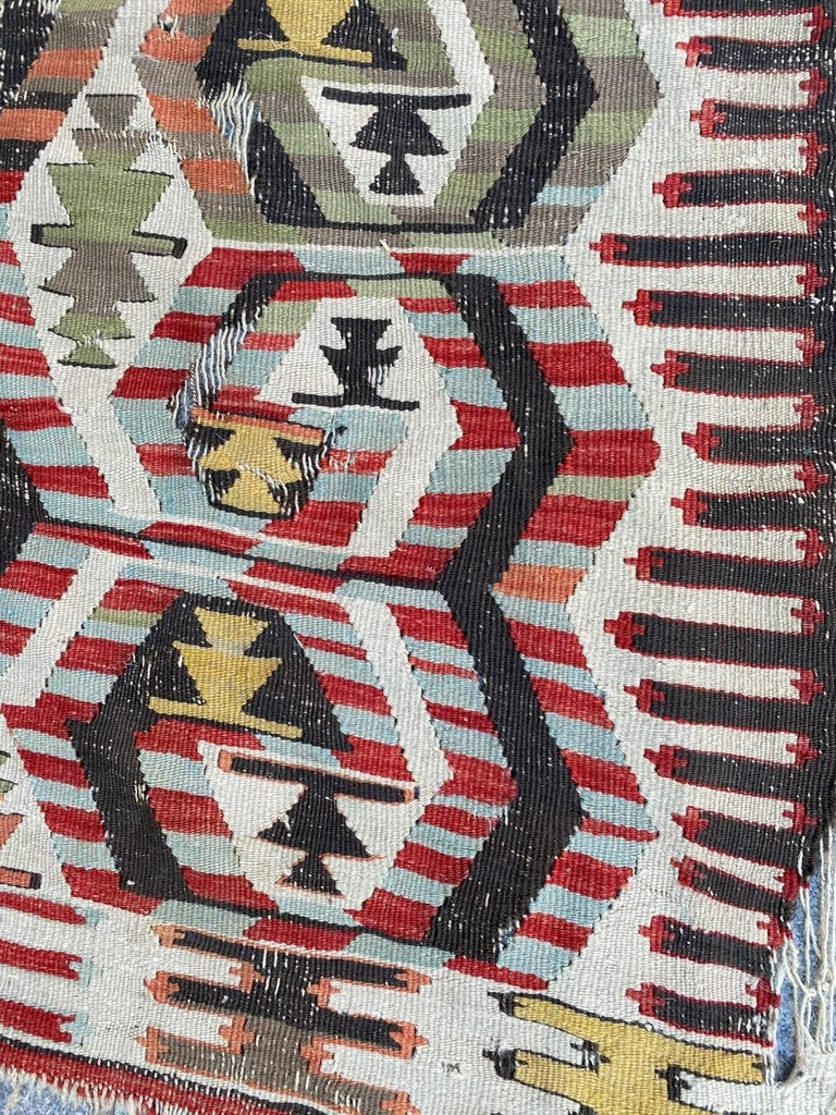 Very beautiful early 20th century Turkish Anatolian Kilim with a beautiful geometrical design and nice colors with dark brown, red, blue, yellow, green, orange and grey, entirely handwoven with wool on wool.