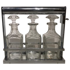 Nice Baccarat Crystal and Jacques Adnet Liquor Bottles Set