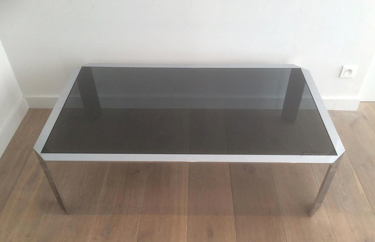 This nice octagonal coffee table is made of chrome with black smoked glass top. This is a French work, very heavy, very good quality, circa 1970.
