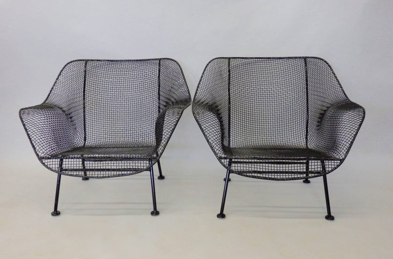 Pair of original and vintage Woodard wide lounge chairs. Recently powder-coated with fresh foot glide installed.