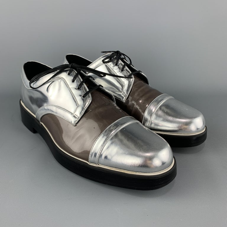 NICHOLAS KIRKWOOD derbys come in metallic silver patent leather with a pearl taupe patent leather mid panel and chunky black sole. Made in Italy.  Very Good Pre-Owned Condition. Marked: IT 42  Outsole: 11.5 x 4 in.