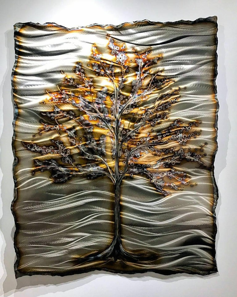 """The Great Magnolia"" Artist: Nicholas Yust Medium: Ground, Plasma Cut & Torched Stainless Steel Hand-Ground Texture, Oxide Torch Coloring, Hand-Layered Clear Coat This wall hanging is sculptural with 4"" relief.  The metal has been bent to create a"