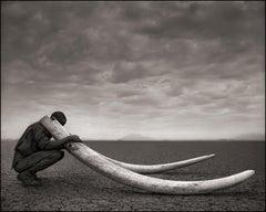 Ranger with Tusks of Killed Elephant, Amboseli – Nick Brandt, Elephant, Africa