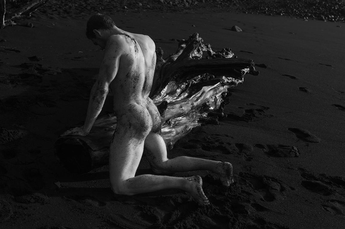 Untitled (Kneeling by Driftwood)