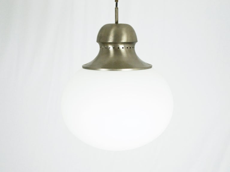 This A298 pendant lamp was produced in Italy by Candle. It is made from nickel plated brass and opaline glass shade. The cable length can be changed on request.