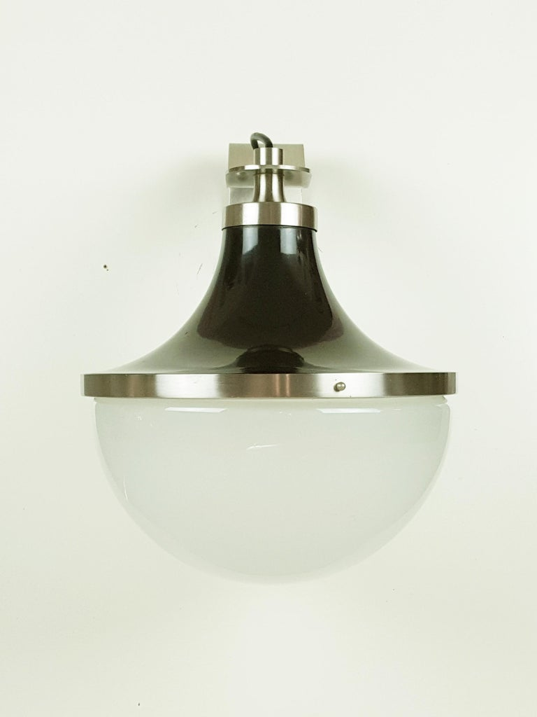 Wall lamps in matt nickel-plated brass. Reflector in dark brown coated aluminum. Frosted glass globe. Very good condition: Normal nickel oxidation.