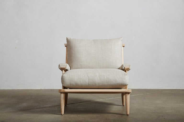 An open silhouette creates a lightweight feeling revealing expert craftsmanship and sophisticated design. Gentle back pitch cushioned by down and feather wrapped high density foam core cushions offer deep repose and generosity for lounging.  As